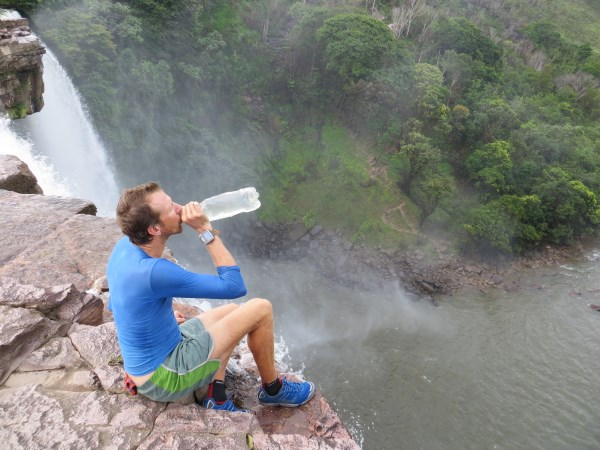 Stopping to change our shoes and drink water in Venezuela from a waterfall